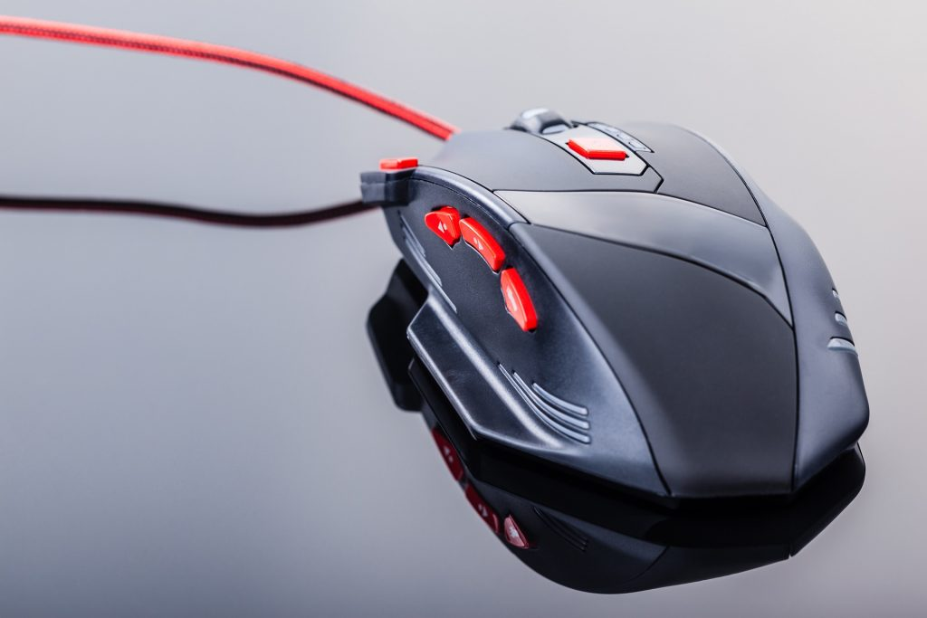 Gaming mouse with red programmable buttons