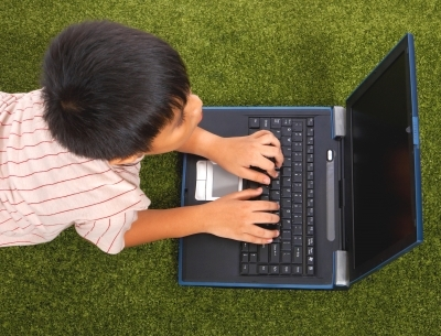 Kid with Gaming Laptop
